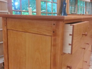 handmade cherry dresser with dovetailed drawers, mortise and tenon joinery and post and panel construction